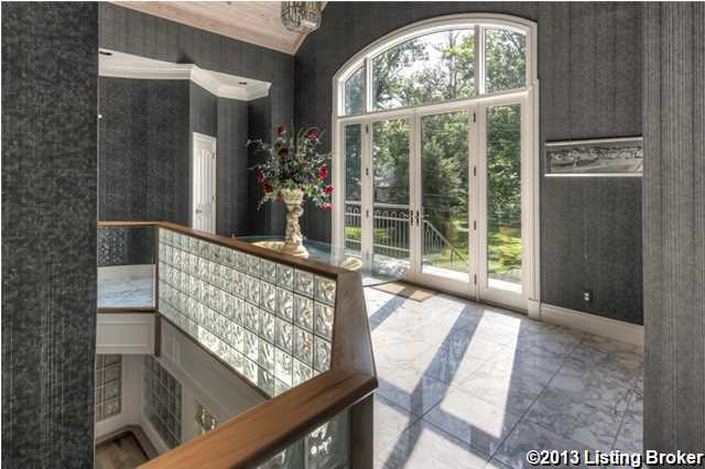The modern 2nd floor foyer's design is not typical for a river house, but is still very much inviting.