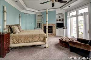 Master bedroom, includes a private balcony, sitting area, and fireplace.