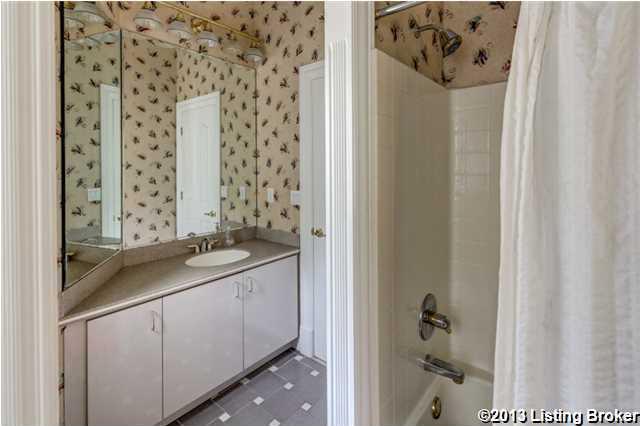 Charming bathroom has a wide vanity space.