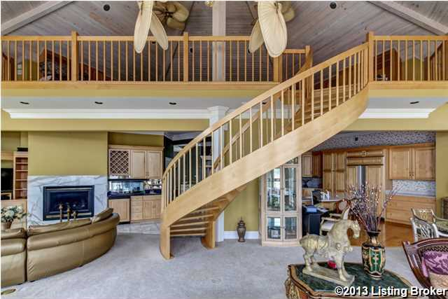 Winding staircase from the kitchen to the top floor.