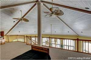 Rustic fans hang perfectly from the gray wooden ceiling.