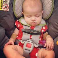 Knock on the window -- if the child is sleeping or groggy, yell for help to break the car window and get the child out of the car