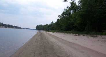 A magnificent forest of hardwoods covers the island's interior, while part of the island is fringed by a sandy beach.