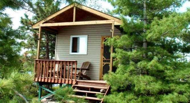The detached Cabin can accommodate up to 4 people and features a lovely pine interior.