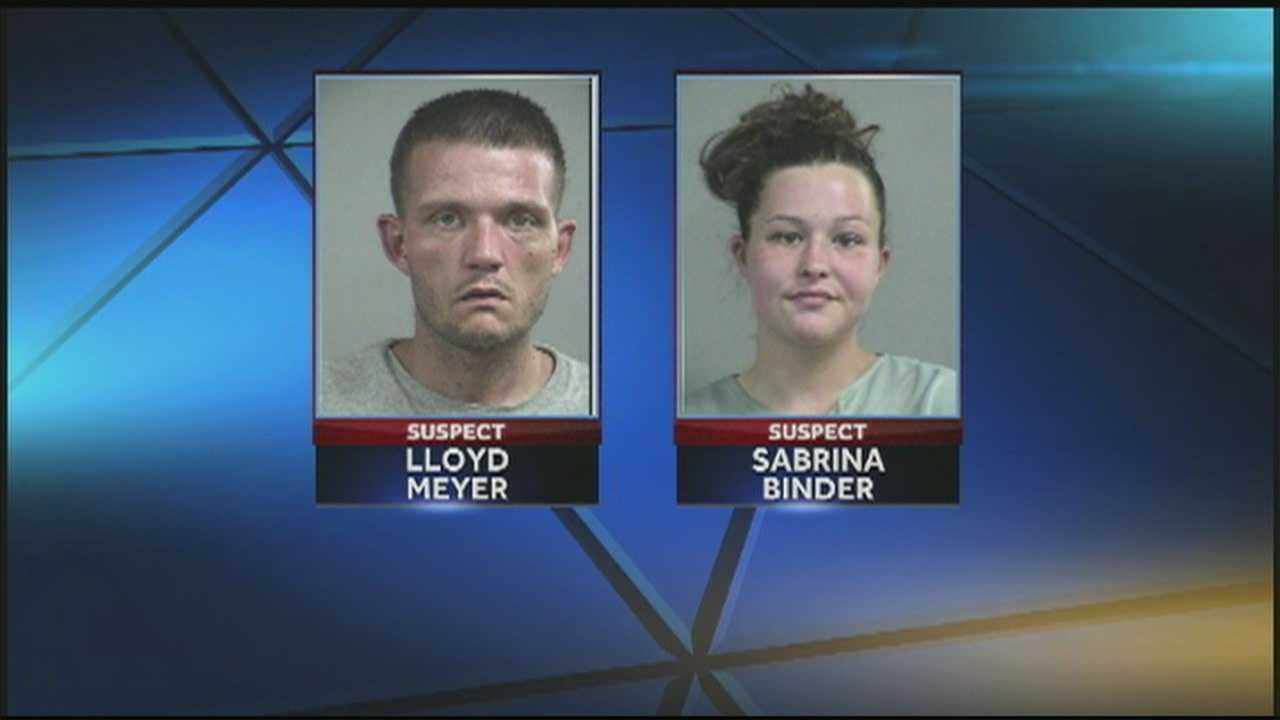 Metro police say they found two people passed out in a car with a toddler in the back seat.