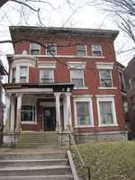 The house has a rich history. At one time it housed the Kentucky state chiropractic offices in the early 1900's. Through the years, it was chopped up to eleven apartments before Banis and Mundt took possession of it. 1435 S. Fourth Street (before)