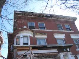 The home at 1435 S. Fourth Street is best known as the home where Joseph Banis killed and buried James Carroll in the basement, but its new owners have returned the 8 bedroom, 7 bathroom, 5 living room 8,000 square foot home to its original grandeur.