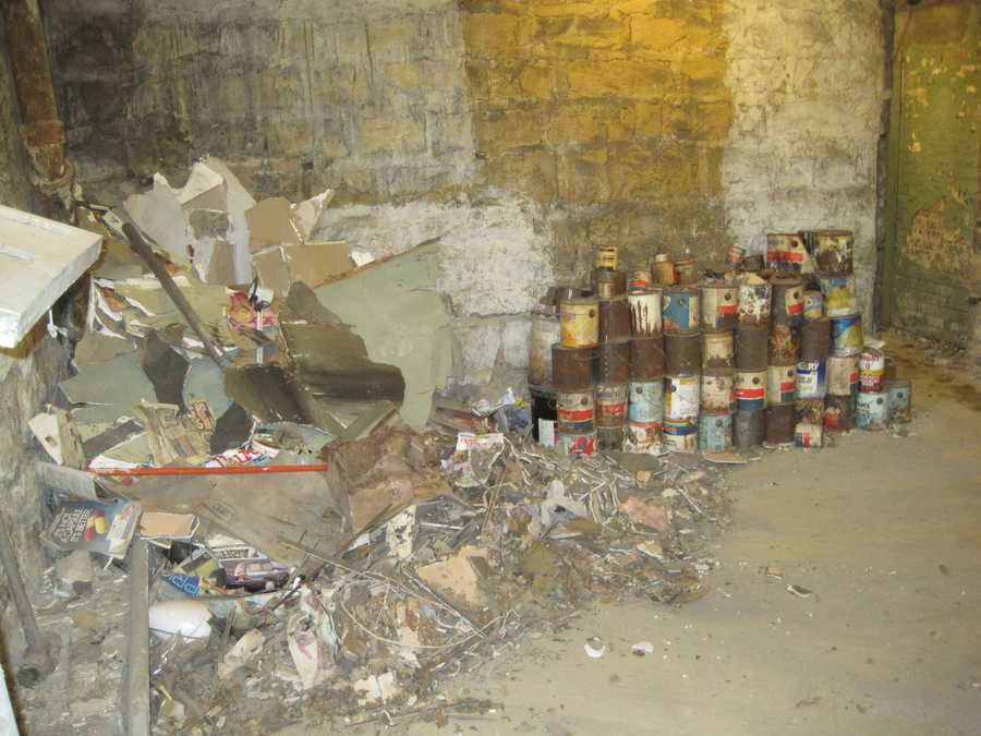 Paint cans in basement before