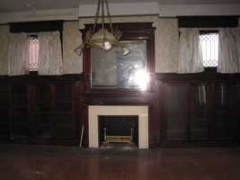 Living rooms fireplace before