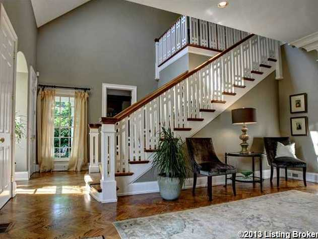 Your tour begins in this spacious foyer.