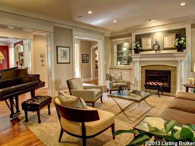 This focal point of this living room is the fireplace, which also features plenty of spacing.
