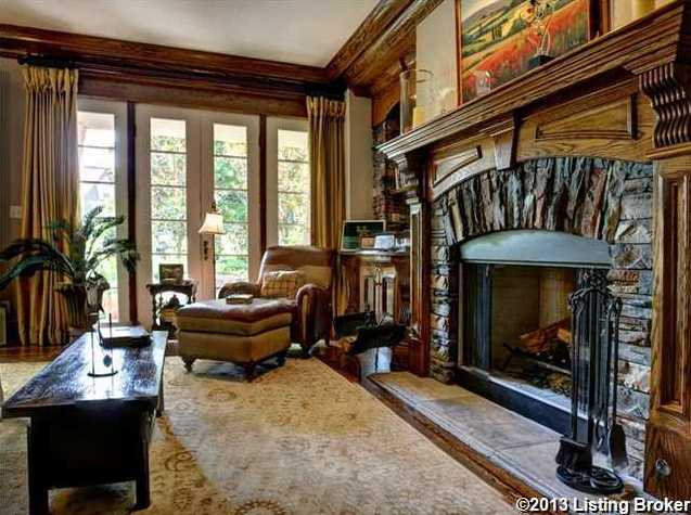 Masterfully designed stone fireplace in this lounge/study space on the ground level.