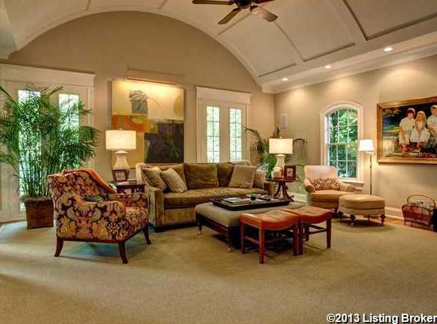 Arched wooden panels grace the ceiling of this living room.