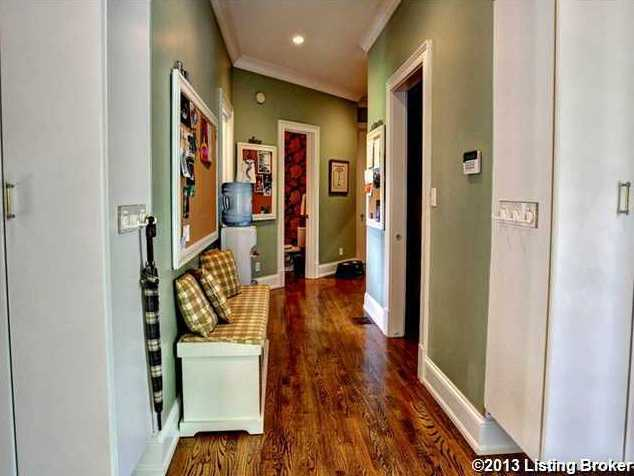 Warm tones and shiny wooden floors could make anyone feel right at home.