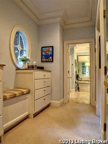 The master bedroom has a breezeway along the closets that leads to the master bathroom.