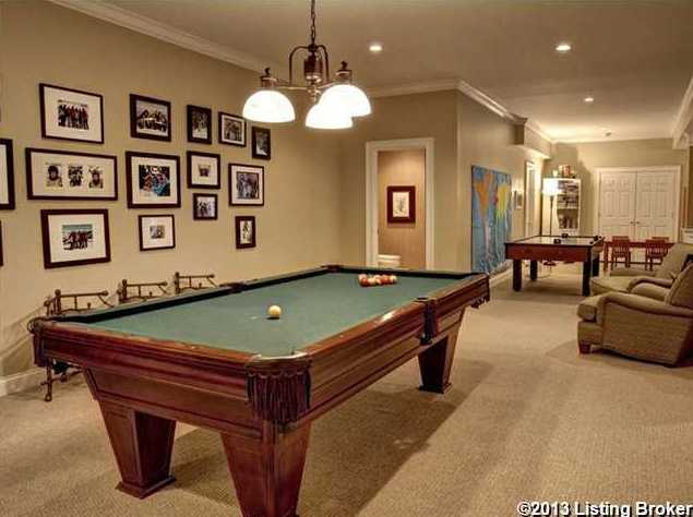 Game room features a pool table.