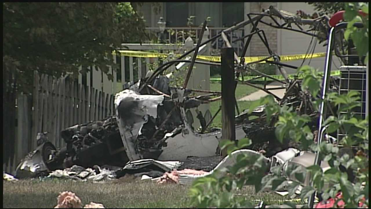 Wreckage remains at a home destroyed by a plane crash in Columbus.