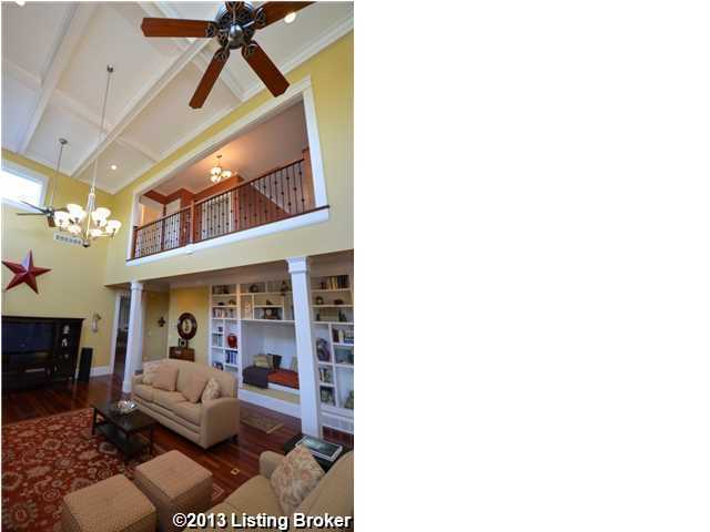 Family room features vaulted ceilings with fans and balcony view from the second floor.