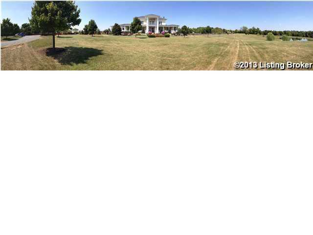 Panoramic view of the expansive property.