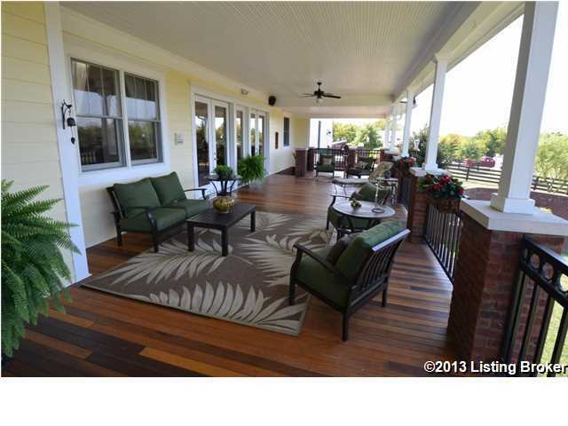 The home's beautiful front porch sprawls the length of the home.