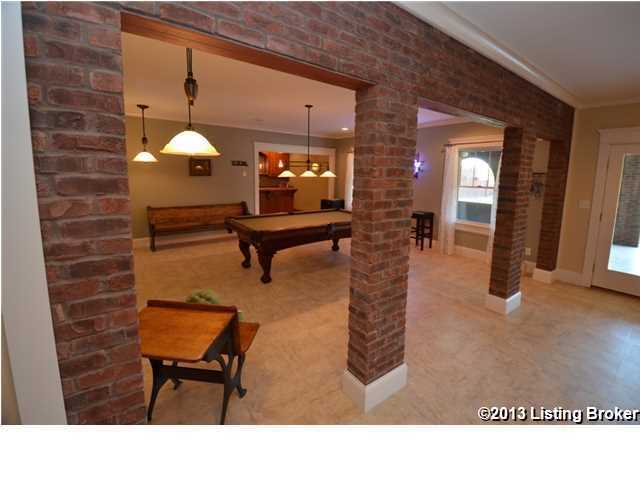 Basement has been renovated and repurposed as an entertainment room.