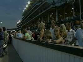 Watch the horses run... at night! Think fun ends after Derby is over? Think again! Churchill Downs opens its doors to public for an event every Saturday night for the public to enjoy.For more information, click: http://www.churchilldowns.com/news/photos/downs-after-dark