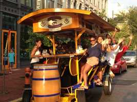 Hop aboard the Thirsty Pedaler: The Thirsty Pedaler is a moving biking bar, that holds up to 15 people. The bike bar stops at differing bars throughout the downtown area. Grab a group of your friends and hop to it!For more information, click: http://www.thethirstypedaler.com/