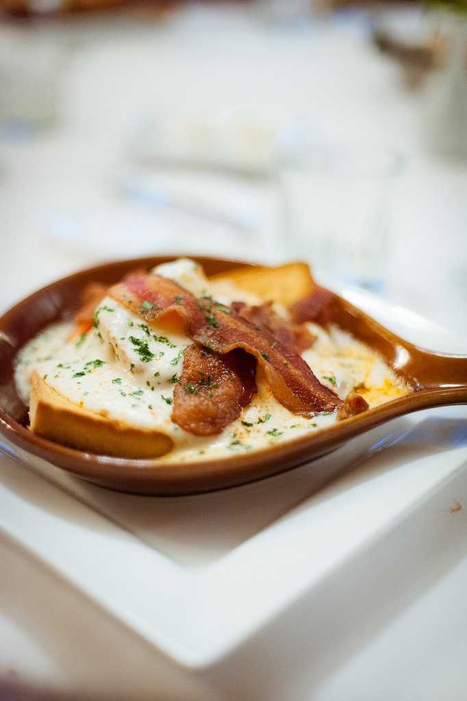 Have a hot brown at the Brown Hotel: The delectable dish encompasses, tasty toast, turkey, roma tomatoes, Romano cheese, Mornay sauce, and bacon.Location:335 W Broadway, Louisville, KY 40202