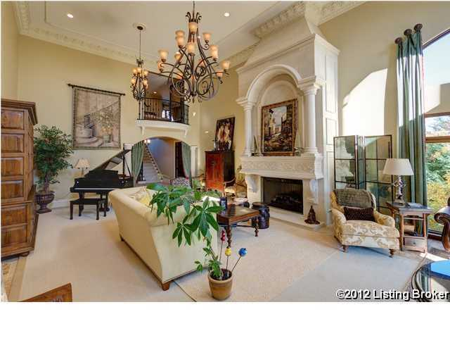 Molded plaster cornices in the formal living room, and crown molding, arched fireplaces and curved wall edges