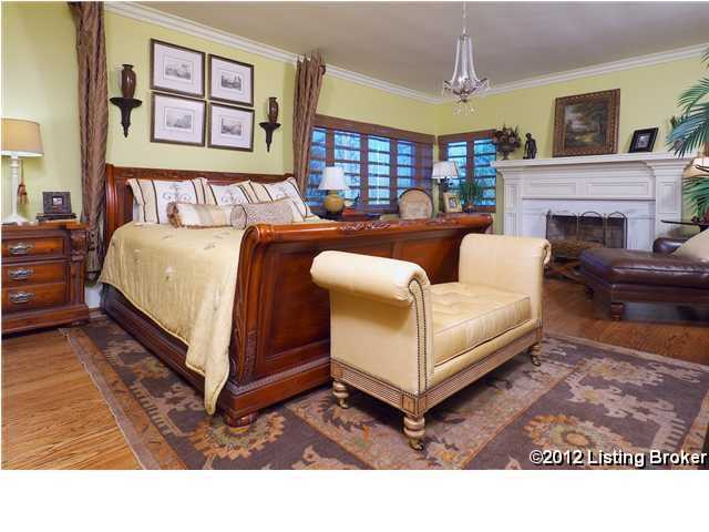 The original upstairs master suite includes a gas fireplace, newly remodeled bath with double vanities and ample closets