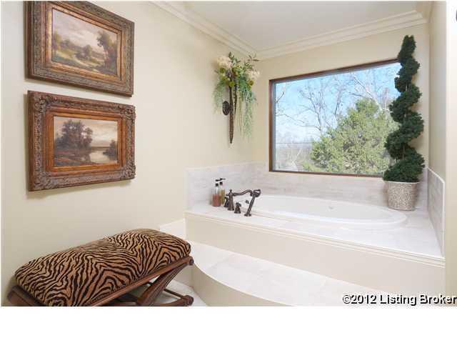 Gracious spa tub in this bathroom suite.