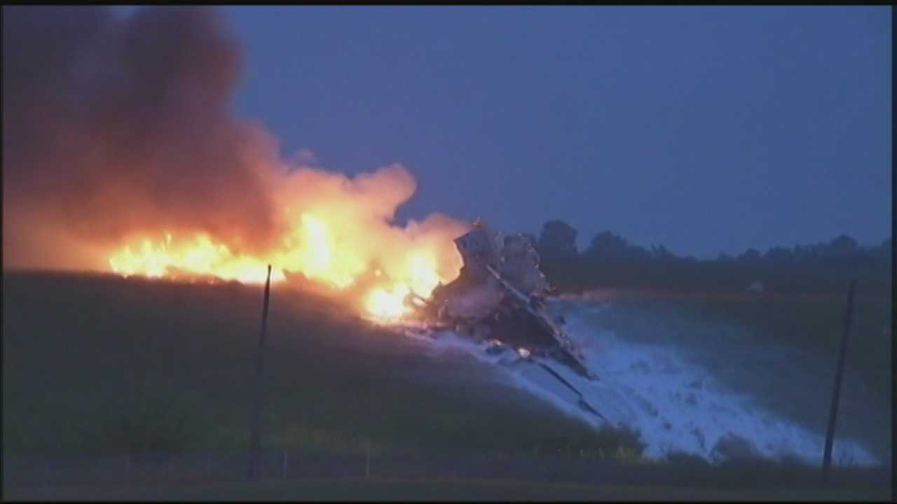 The pilot and co-pilot of a UPS cargo plane died Wednesday when their jet crashed, broke into pieces and burned near the Birmingham airport.