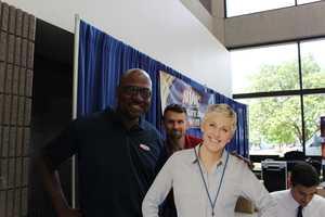 Creative services director Bruce Burns greets Ellen.