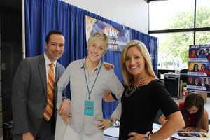Reporter Matt McCutcheon and morning anchor Karen Roby try to figure out how tall Ellen is.