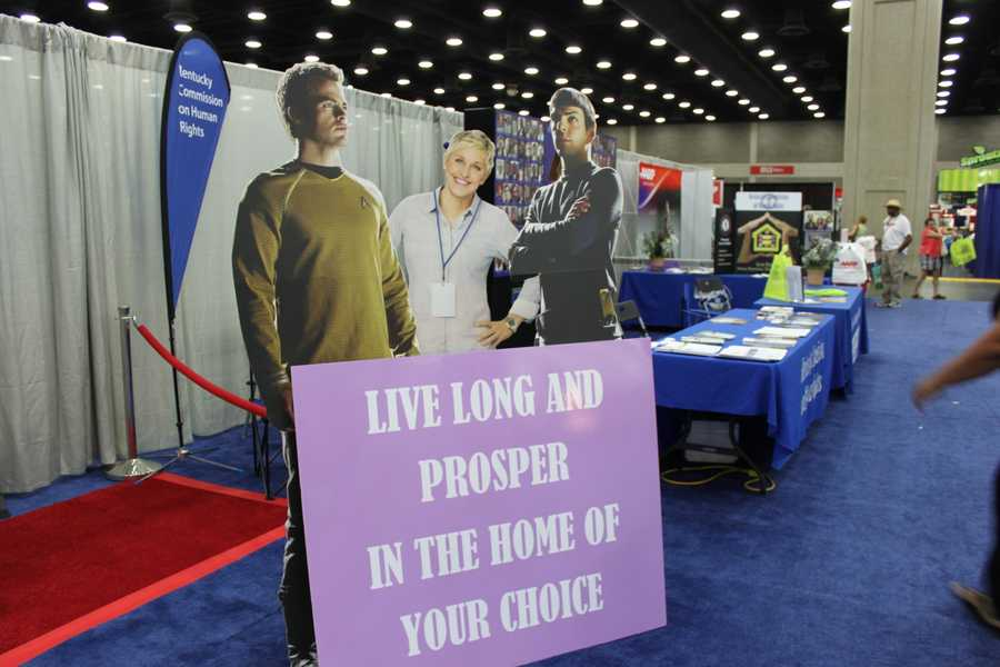 Ellen makes friends with some out-of-this-world guys at the booth for the Kentucky Commission on Human Rights.