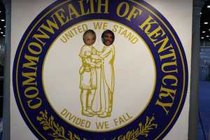Ellen becomes a part of Kentucky by posing with creative services producer Nathan White in the state seal.