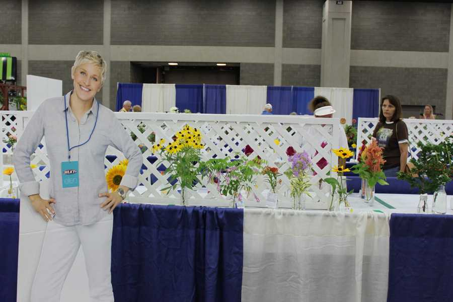 Ellen takes time to stop a smell the prize winning flowers.