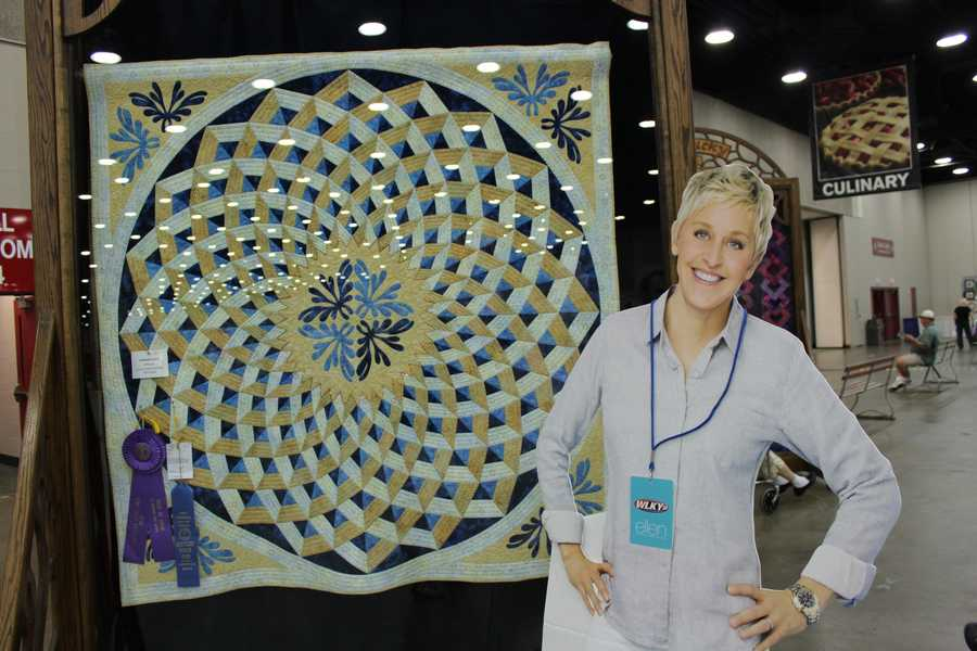 Ellen's admiring the hard work and dedication of the prize-winning quilts.