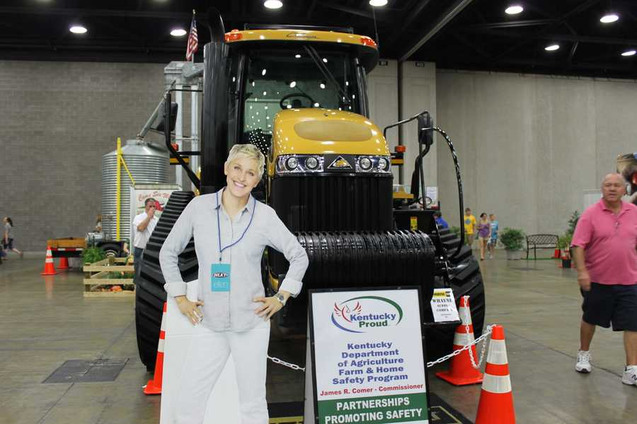 Ellen poses with one of the many tractors on display at the state fair. Maybe next year she'll be able to take a test drive.