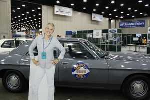 If you come to the Kentucky State Fair, you HAVE to pose with an old state police car.