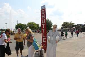 After walking all over the fair, Ellen hangs out with some fans at the shuttle stop.