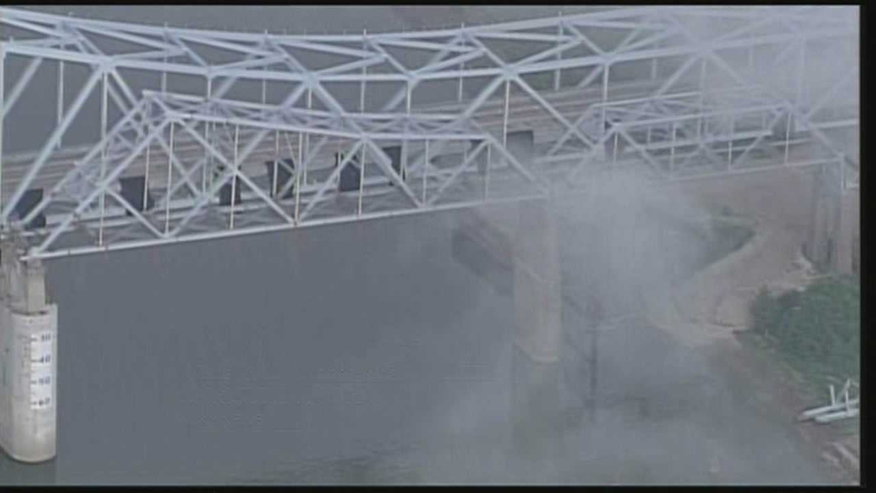 A 400-foot long section of the old Milton-Madison Bridge was blown up Thursday morning.