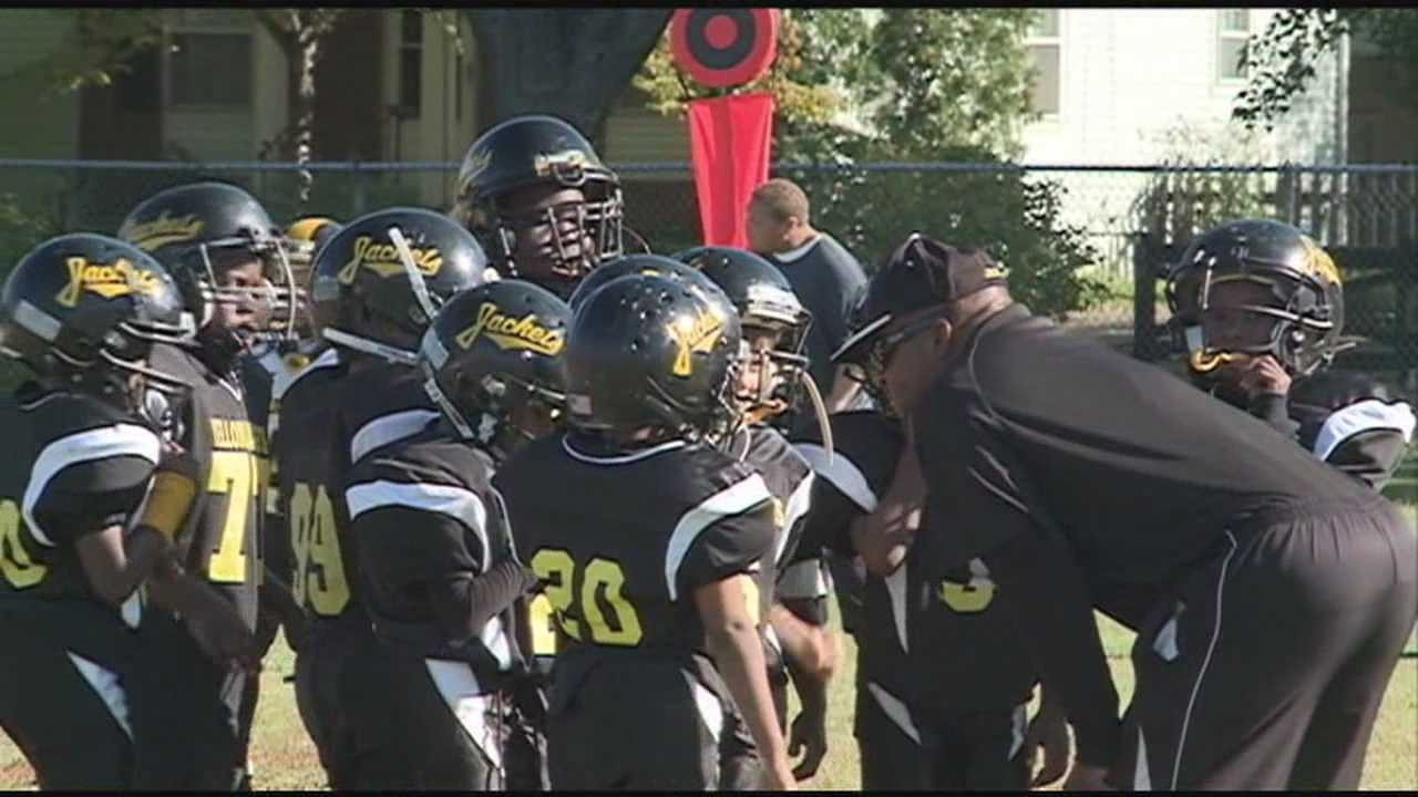 The Yellowjackets in the Mighty Mite youth football division took the field in Louisville on Saturday, as did the coach many are now calling a hero.