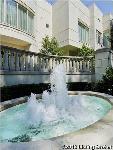 An eye- catching fountain sits in front of the mansion's outer footsteps.