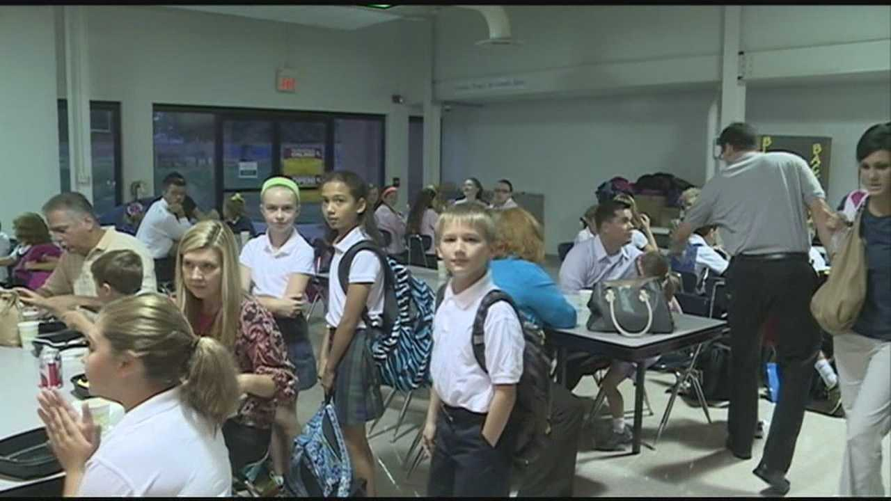 Volunteers serve breakfast benefiting Blessings in a Backpack
