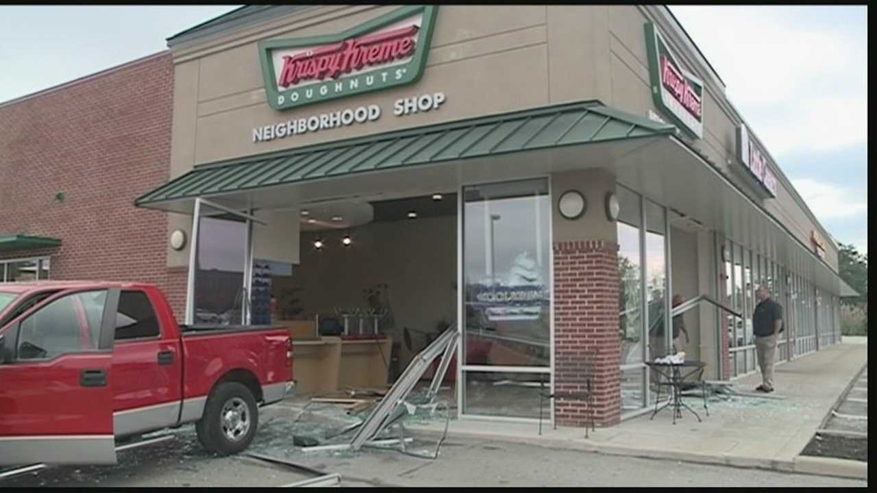Authorities said a woman in a red Ford F-150 truck drove into the front of the business, took a hard left and went out through the side.