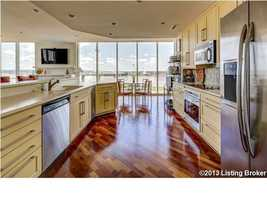 This beautiful kitchen covers all the needs for a creative chef and entertaining. It features custom cabinetry kitchen expansive bar area, stainless steel appliances and ice maker and large walk-in pantry with custom shelving.