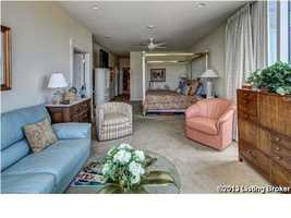 The master suite has seating area, king size space with two major walk-in closets.