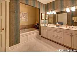 Luxurious master bath features a spa tub.