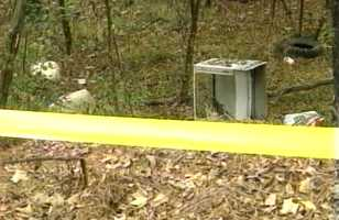 The coroner said her body had been moved to two different spots about 15 feet apart at the site where it was found.
